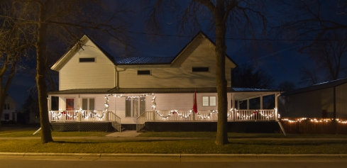 Before (I only have pictures of the porch with our pretty Christmas lights up!)